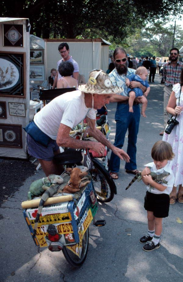 """Iguana Man"" shares his pets in Key West. (1984) 