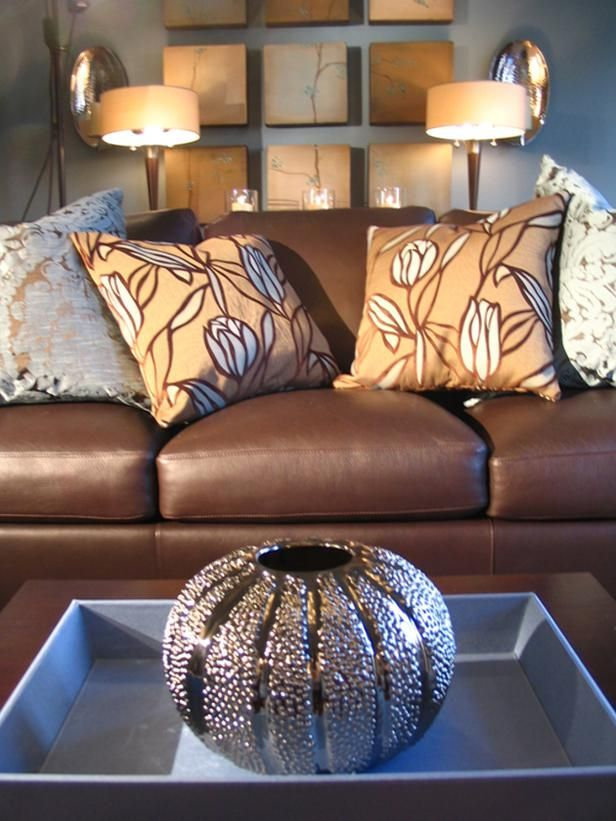 Traditional living room gets a modern twist - Throw pillows for brown sofa ...