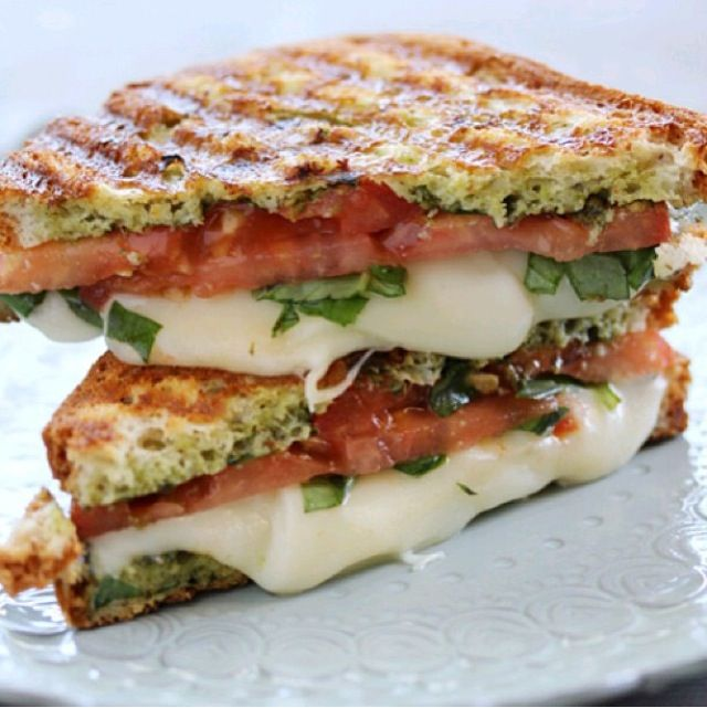 whole wheat roasted bread with melted mozzarella cheese, sliced tomato ...
