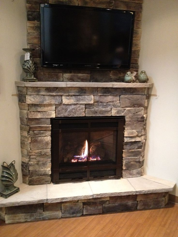 Decosee tv above fireplace Corner rock fireplace designs