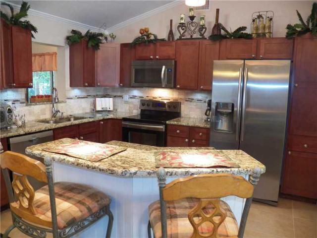 Best Cherry Cabinets White Island Coastal Living And Florida 400 x 300