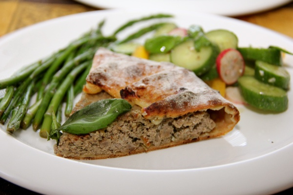 slice of Open Face Lamb Pie with asparagus and cucumber salad