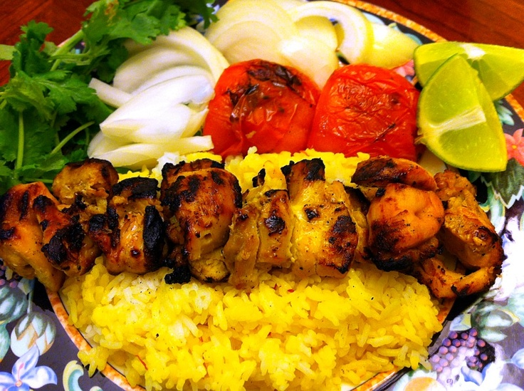 Persian chicken kabobs with grilled tomatoes.