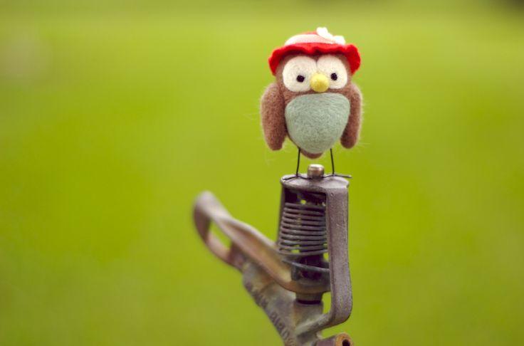 owl on a sprinkler