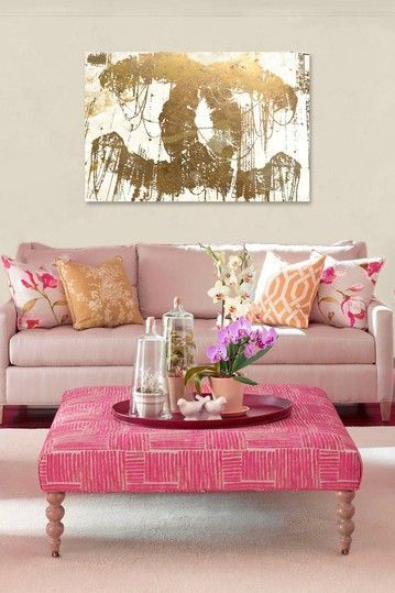 The gold Chanel painting and pink make this such a classy sitting area