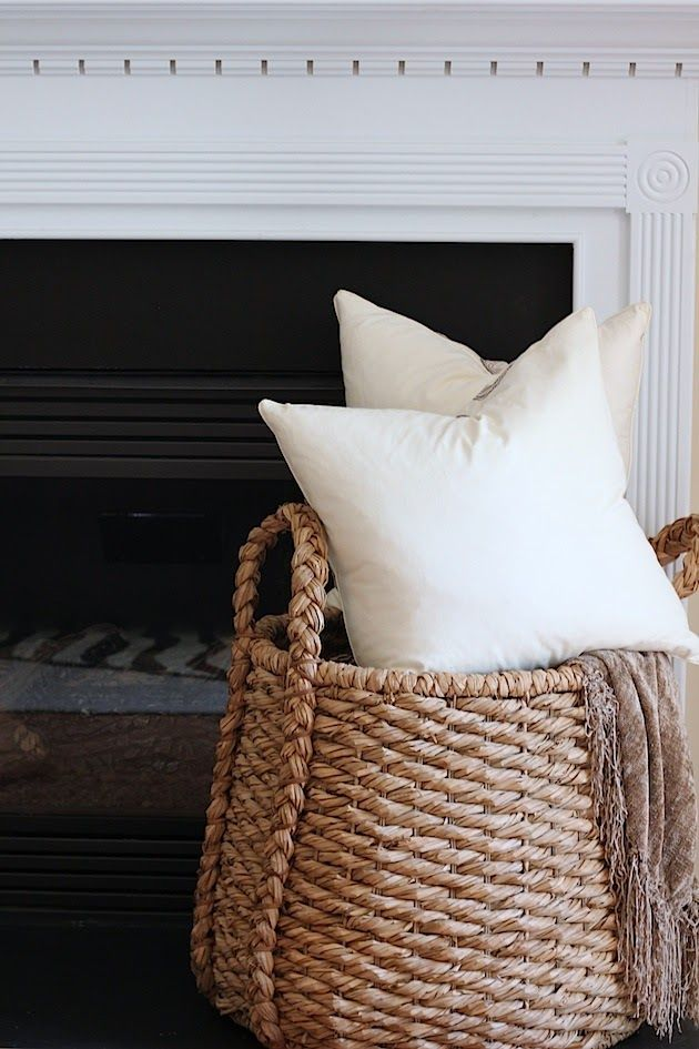 Basket to hold pillows and a blanket home decor for Living room blanket storage