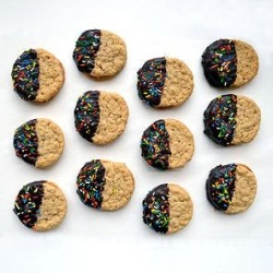 Oatmeal sandwich cookies filled with peanut butter cream and dipped in ...
