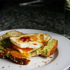 Whole Grain Toast with Mashed Avocado and An Egg