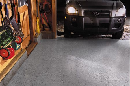 An epoxy coating on the garage floor resists oil stains, beads water, and wipes clean like a kitchen counter