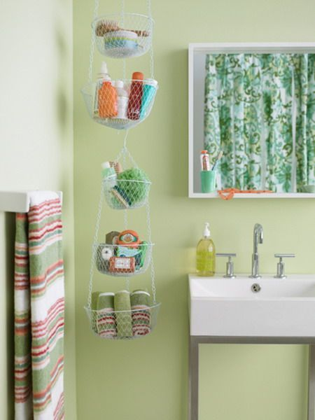 Hanging planter baskets as bathroom handtowel, soap, toiletry storage! Cute and organized. | shelterness.com