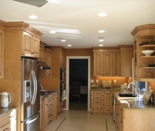 Traditional Galley Style Burnt Orange kitchen, maple beach cabinets, $