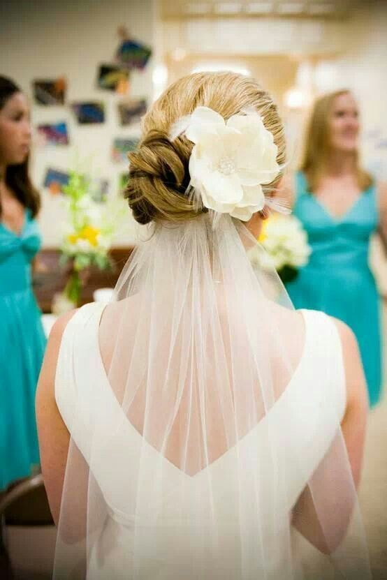 Wedding updos with veil and flower :