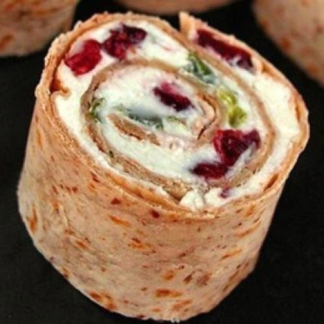 CRANBERRY FETA PINWHEELS   1 carton (8oz) whipped cream cheese, softened 1 c (8oz) crumbled feta cheese 1/4 c chopped green onions 1 pkg (6oz) dried cranberries 4 flour tortilla (10in)   In a small bowl, combine the cream cheese, feta cheese and onions. Stir in cranberries. Spread about 1/2 c mixture over each tortilla & roll lightly. Wrap with plastic wrap and refrigerate for at least 1 hour. Cut each roll-up into 10 slices.