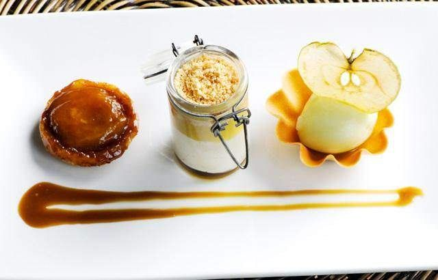 Assiette of apples with apple sorbet, panna cotta and butterscotch sa ...