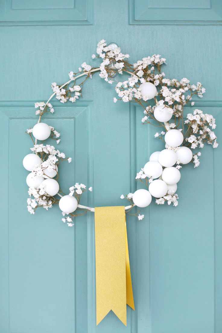 Make this delicate white winter wreath with a coat hanger and ping pong balls