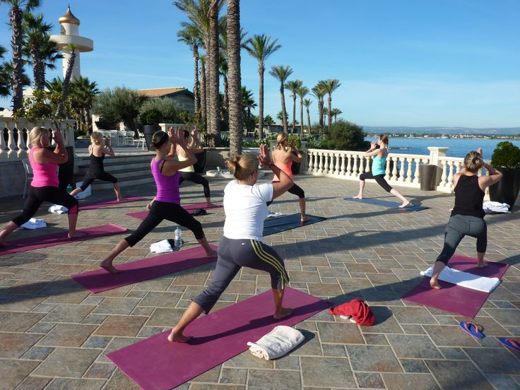 Lunges facing the sea on our luxury yoga holiday in sicily