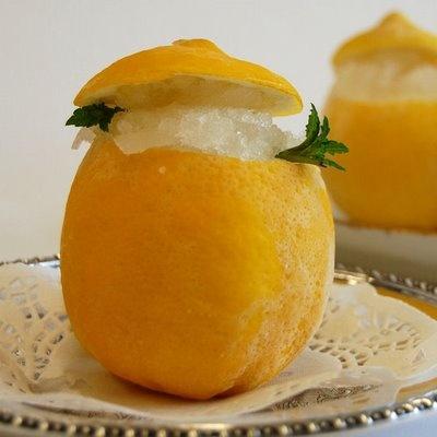 Lemon granita served inside a lemon. | Foodie | Pinterest