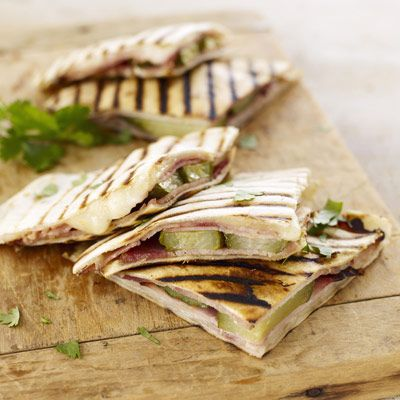 These grilled Cuban sandwich-style quesadillas are easy to eat out of ...