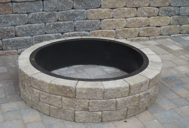 Do it yourself round stone fire pit fireplaces fire for Do it yourself fire pit ideas
