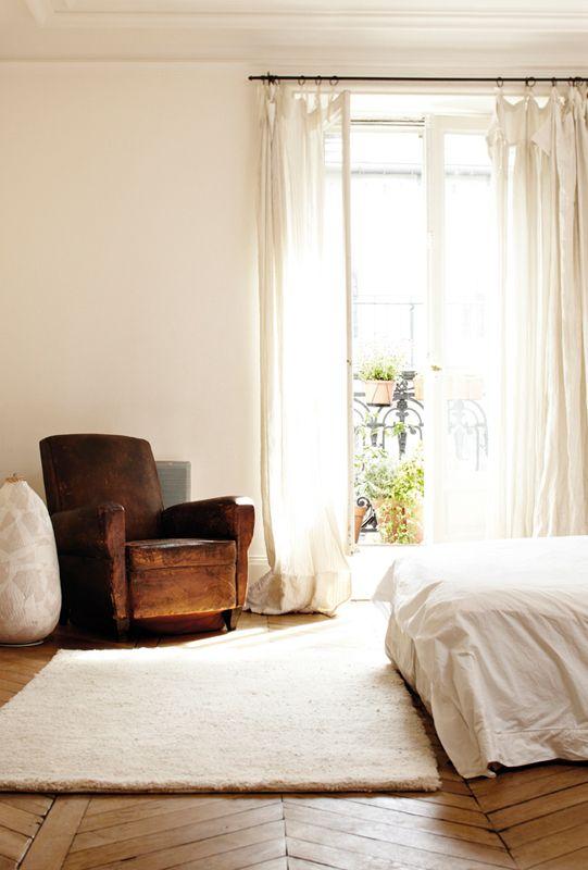 Love the herringbone floors & the worn leather chair