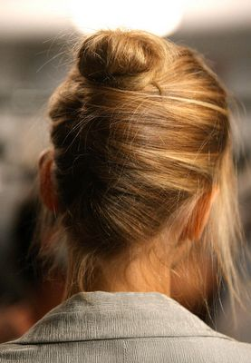 a *slightly* messy chignon. perfect. #hair