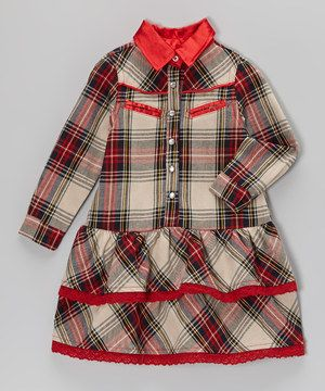 Like a peppy plaid print and slit front pockets give this dress