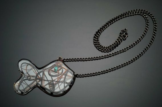 Rodney M. Winfield, USA: fish pendant 1945. Copper and turquoise embedded in acrylic; silver chain