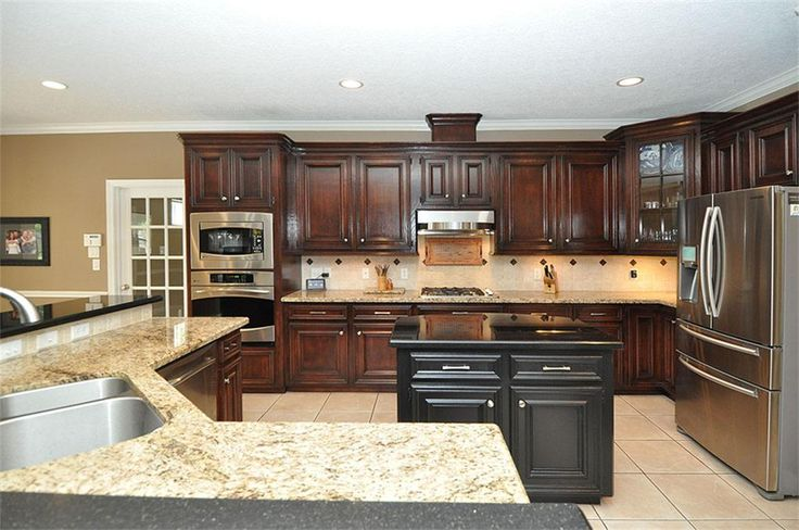 Dark stained oak cabinets kitchen pinterest for Black stained kitchen cabinets