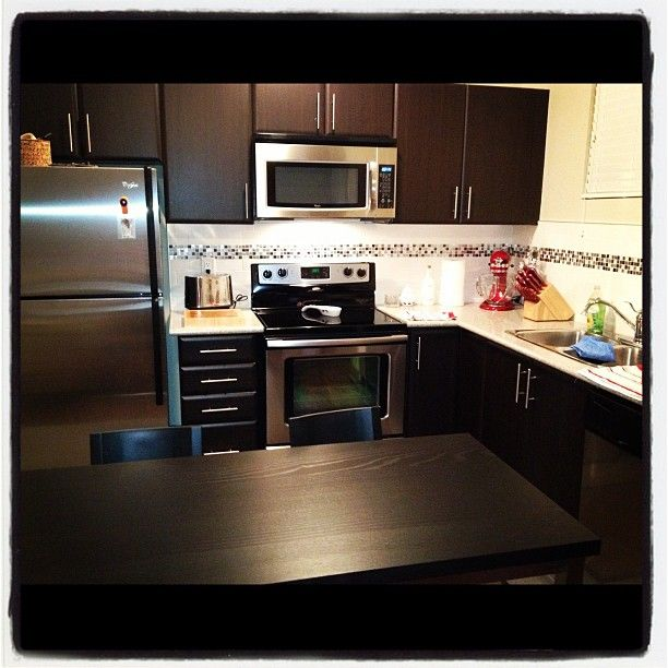 Dark Kitchen Cabinets With Light Countertops: Dark Cabinets On Light Countertops....