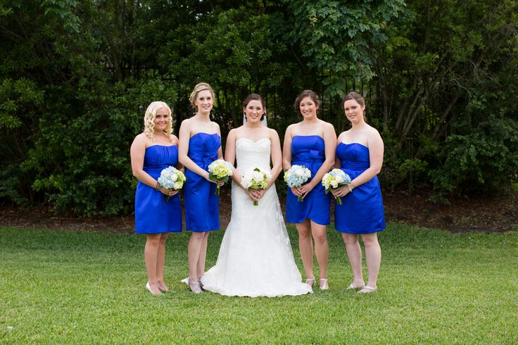 Bridesmaid's in vibrant blue| Blue, White & Green Wedding at The Woodlands Resort via  http://www.weddingcolors.net/ashley-birkirs-wedding-at-the-woodlands-resort.html | Photo by: clairemiranda.com