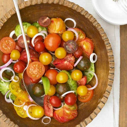 Daily Dish: Tomato and Red Onion Salad. Get more Daily Dish recipes here: http://bhgfood.tumblr.com/post/22192893889/daily-dish-a-sweet-sour-vinegar-dressing-adds/?socsrc=bhgpin071312tomatoonionsalad