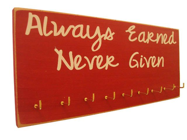 inspirational sports quotes for medals holder. $28.00, via Etsy.