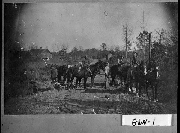 Gwinnett County, ca. 1918. Members of a road crew that was working of Ga. Highway 20 near Lawrenceville. Left to right: W. C. Poarch, W. H. Poarch, Wylie Thorndyke, S. R. Martin, Bole Burnett, Dudley Burnett, Pink Brown, W. H. Brown (overseer).