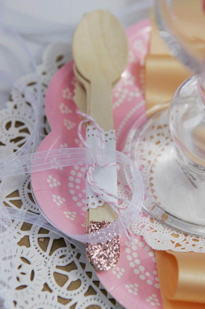For a girly touch, dip your disposable utensils in glitter and wrap in mini-doily! Ooh-la-la! #partydecor