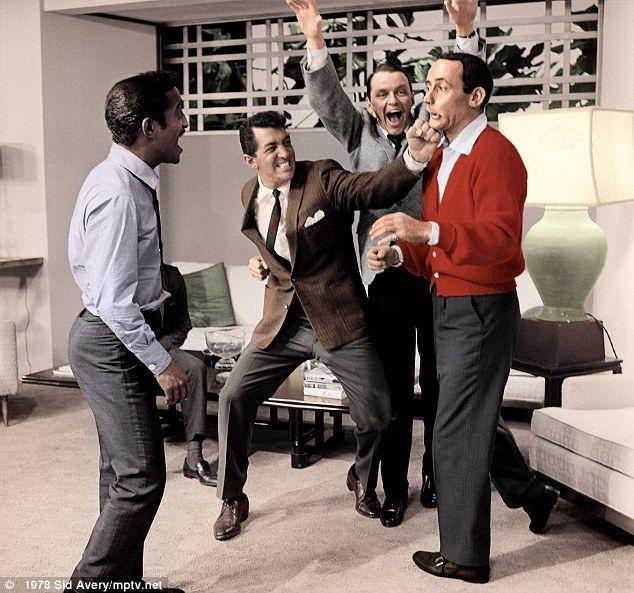 Sammy Davis Jr, Dean Martin, Frank Sinatra and Joey Bishop clown around on the set of Ocean's Eleven in 1960 (Daily Mail).