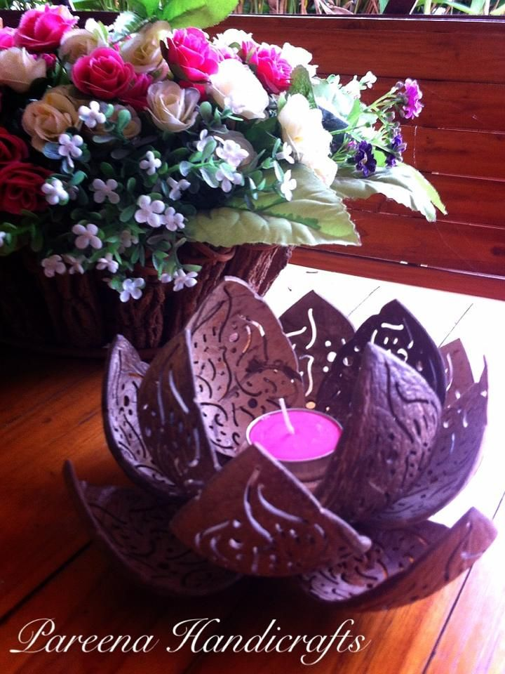Coconut Crafts Lotus flower candle holder  http://coconutshellcrafts.com/