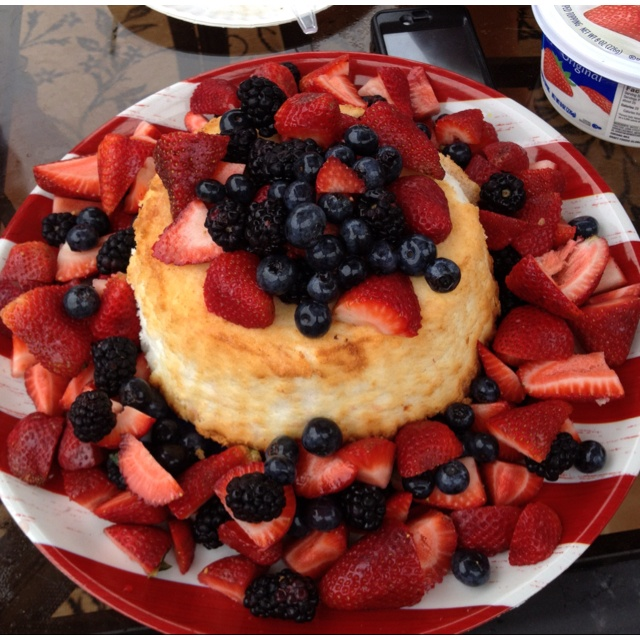 Angel food cake with mixed berries and cool whip. Red, white, and blue ...