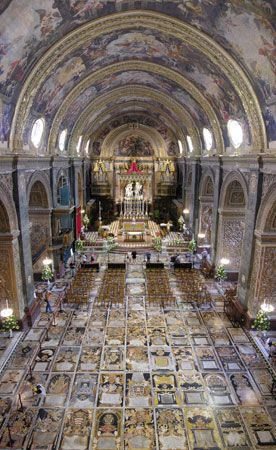 The magnificent floor of the Co-Cathedral of St. John, made up of more than 350 polychrome intarsia marble tombstones.  This is in Malta