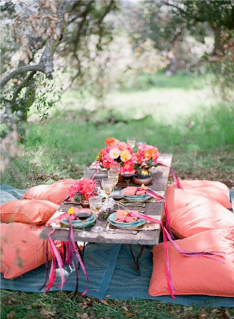 Picnic outside? Re-create this look with flowers from Bouquet Boutique, overlarge pillows from Rylo Interiors or Olive Home and table settings from Du Monde. Ribbons from the Fabric Store.