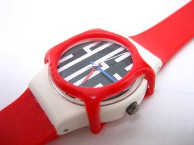 Swatch watch (face protector included).