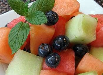 melon and blueberry fruit salad in rum lime sauce