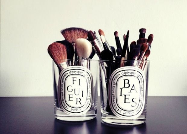 organized makeup brushes in repurposed candle jars