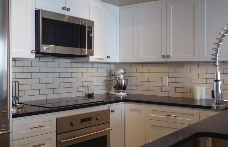 to create the modern backsplash for this condo kitchen