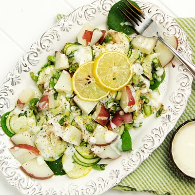 Salad of squash, zucchini, asparagus and red potatoes, drizzled with a ...