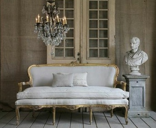 chandeliers and white or gray patined furniture...