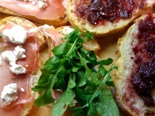 Toasted fig spread, prosciutto, arugula, and goat cheese sandwiches.