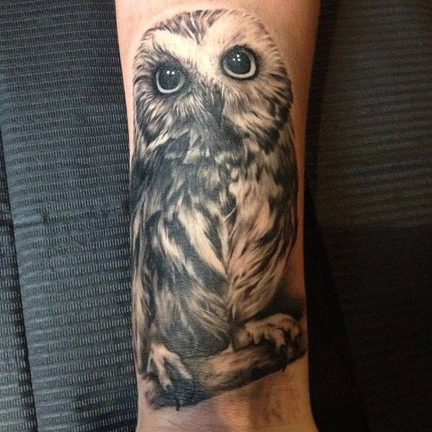 Sexy and feminine owl tattoo