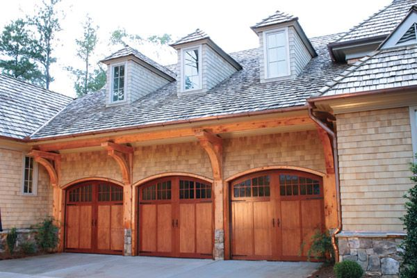 Stained garage doors future home pinterest for Wood stained garage doors
