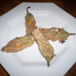 Delicate, crispy fried zucchini flowers stuffed with ricotta cheese