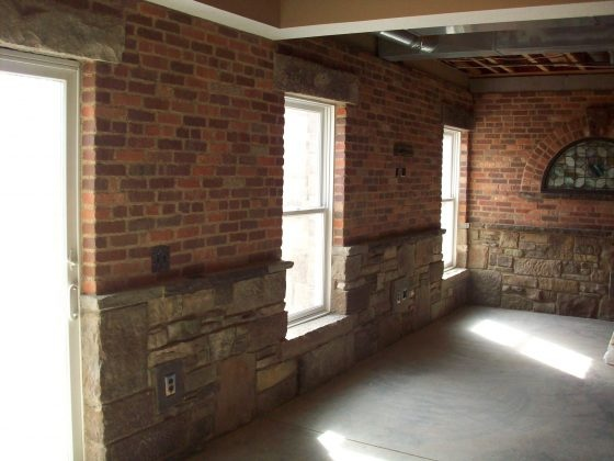 finished basement inspired by an old english pub foundation stone